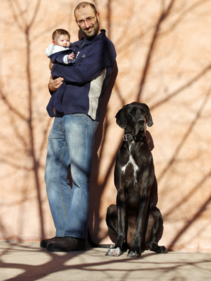 Keeping it in the family:  Isabel Vineyard winemaker Carlos Orgiles, with 3-month-old daughter Juno, and dog Luna, the great dane in residence, at the company's base in Renwick.  Mr Orgiles hopes to pass on his exuberance for all things concerning grapes to Juno, who was born during this year's vintage. Juno's mother Jane Tiller is assistant winemaker at Isabel Vineyard.