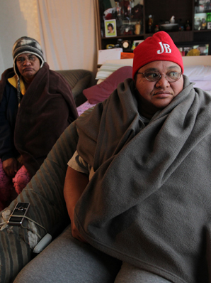 Cold winter weather has this family wrapping in blankets to keep warm.  Donna Kahukiwa, left and Leander Jacob