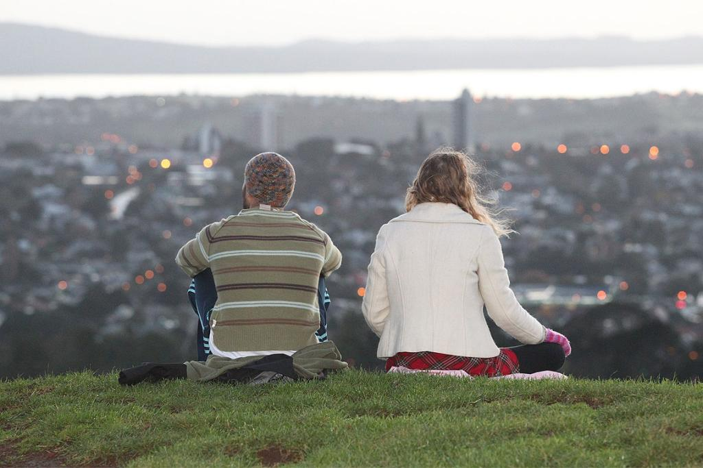 A couple look out over Auckland after the Matariki dawn service on One Tree Hill.