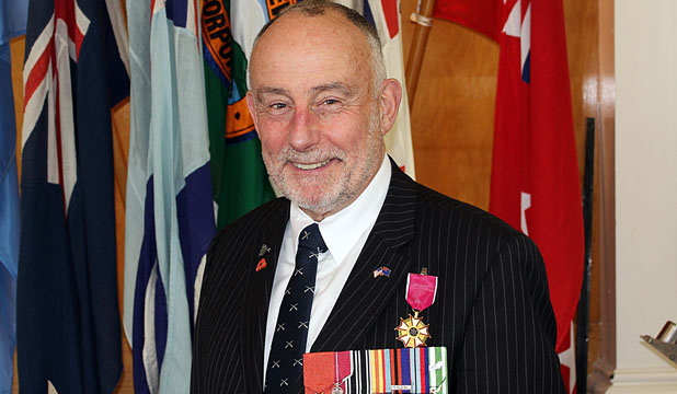 MEDAL OF MERIT: retired NZ Army lieutenant colonel Christopher Mullane was officially presented with the US legion of merit (the medal with the pink ribbon) 33 years after it was recommended.