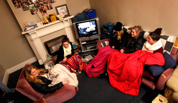 RUGGED UP: From left, Johanna Poole, Remai Parker, Rebecca Noakes, Shelly Mellow and Jessica Perry sit in a cold Palmerston North flat  and the heater is not working.