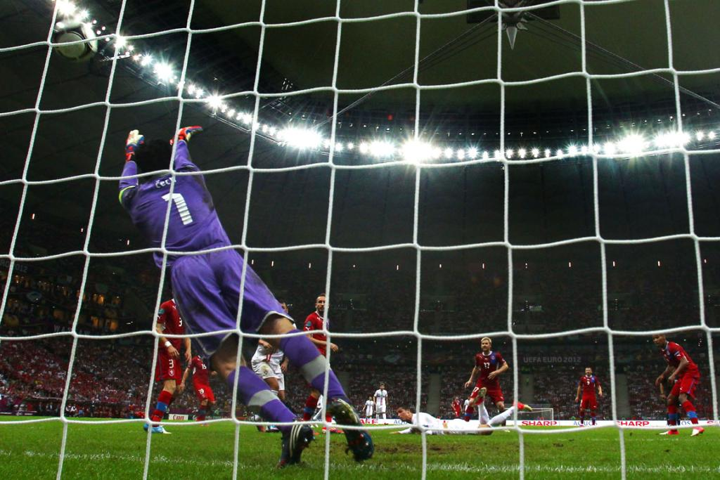 Cristiano Ronaldo of Portugal scores the winning goal with a header past Petr Cech of Czech Republic during their quarter-final match.