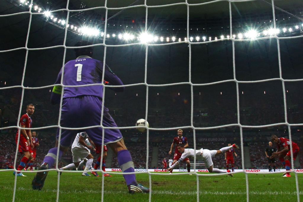 Cristiano Ronaldo of Portugal scores the winning goal with a header past Petr Cech of Czech Republic during their quarter final-match.