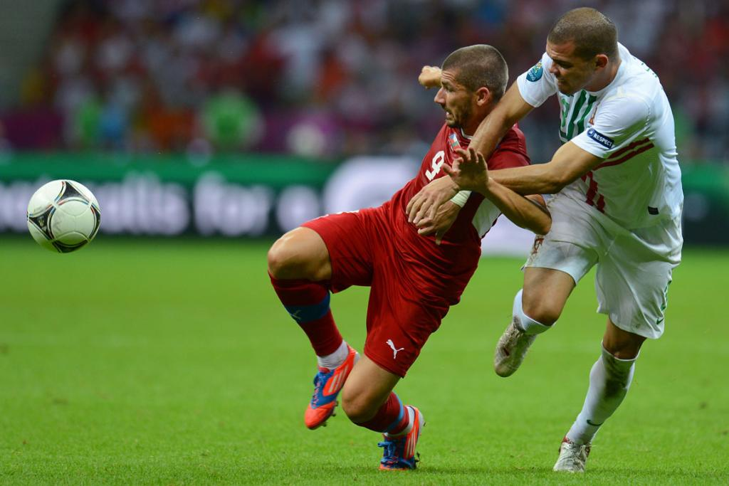 an Rezek of Czech Republic and Pepe of Portugal battle for the ball during their quarter-final match.