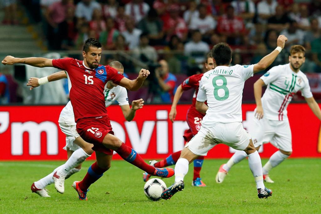 Czech Republic's Milan Baros, left, fights for the ball with Portugal's Joao Moutinho during their quarter-final match.