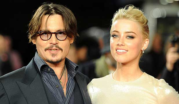 "HAPPY SINGLE: Johnny Depp is reportedly not ""embroiled in some hot and heavy new romance"" with Rum Diary co-star Amber Heard."