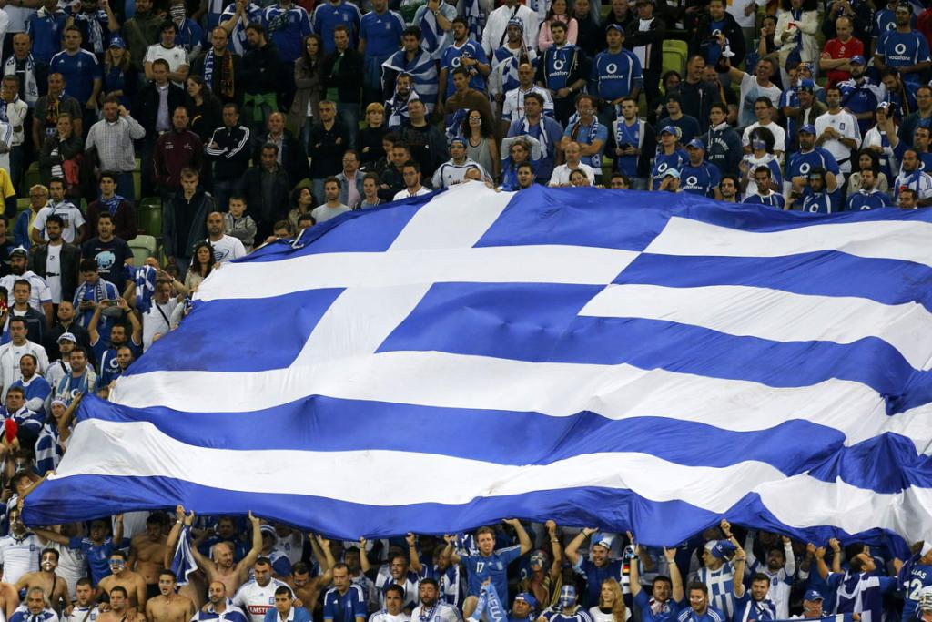 Greece fans wave a giant flag in the crowd as their team took on Germany in the quarter-finals.