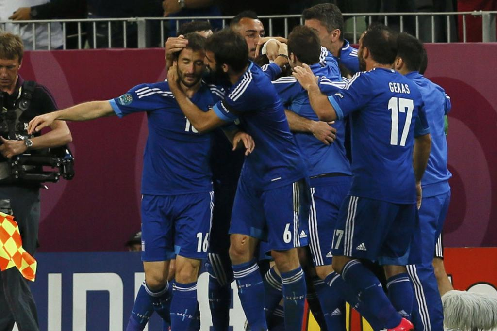 Giorgos Samaras celebrates with team mates after scoring a goal in their quarter-final loss to Germany.