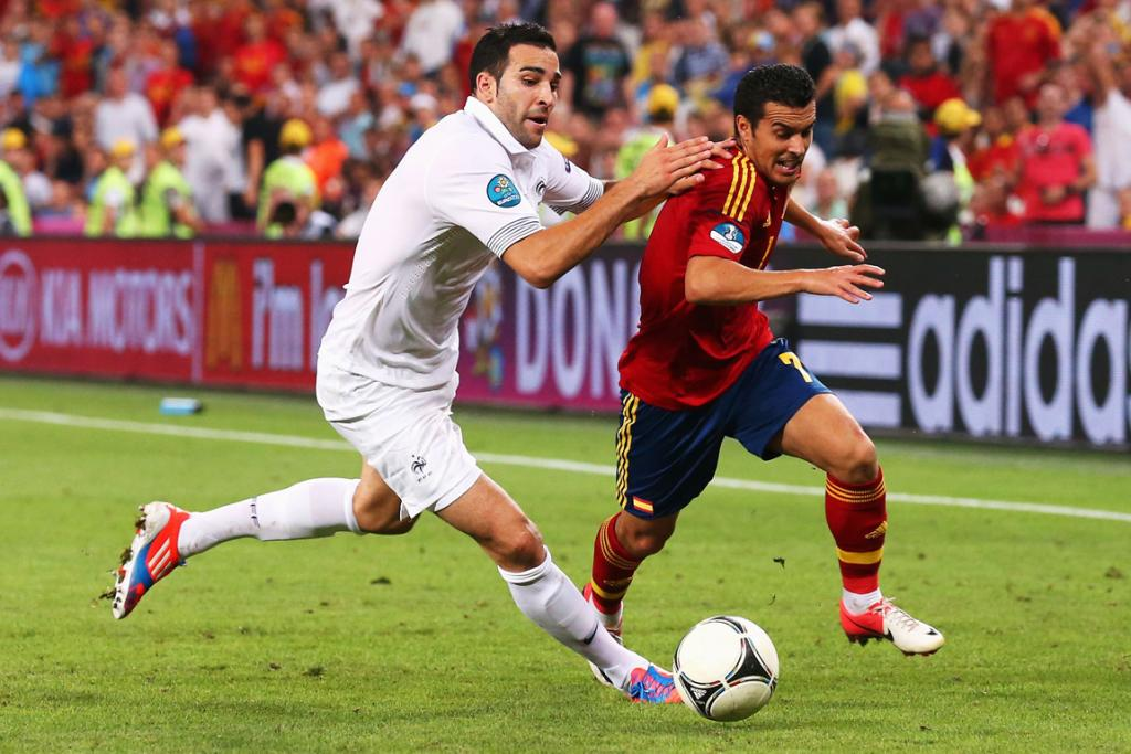 Adil Rami of France battles with Pedro of Spain during their Euro 2012 quarter-final.