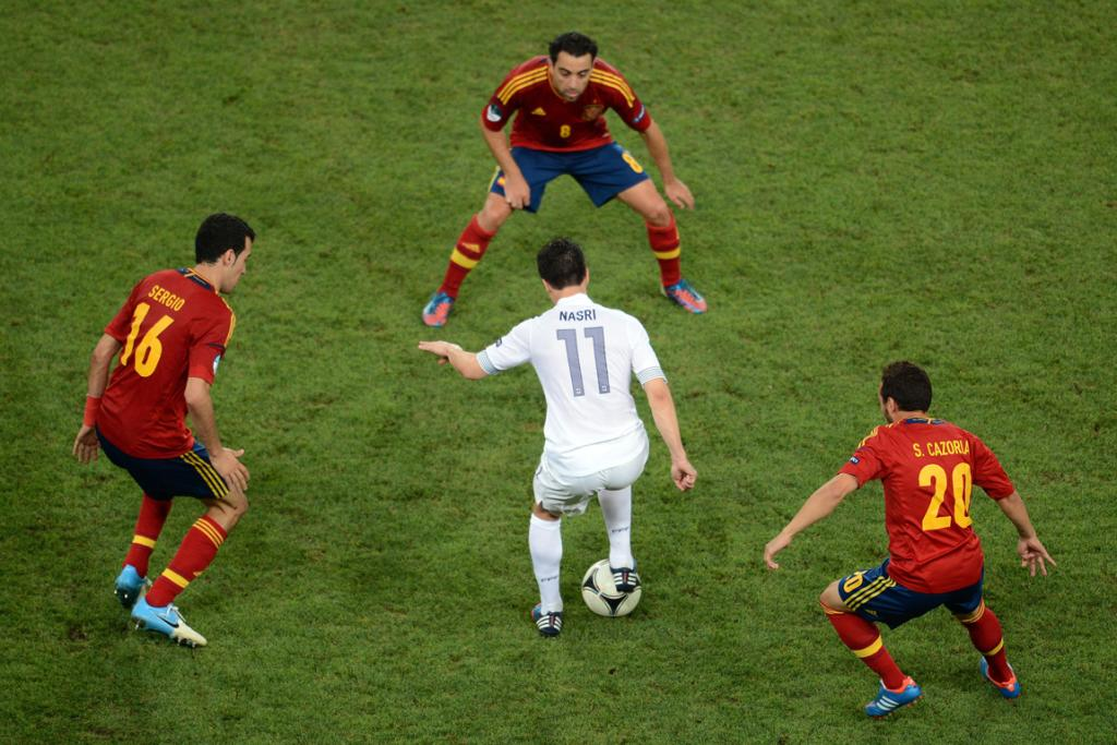 Samir Nasri of France is surrounded by Spanish players during his side's 2-0 loss in the Euro 2012 quarter-finals.
