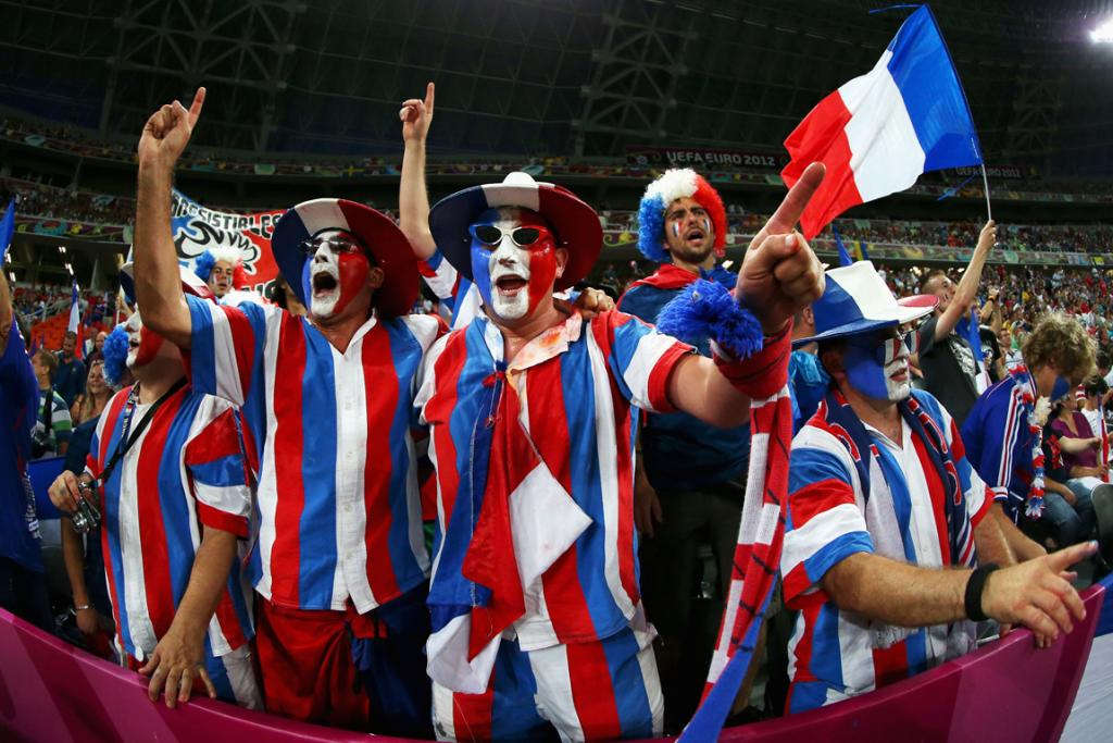French fans cheer for their side during the quarter-final against Spain.
