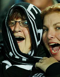 CHEER SQUAD:  Vocal All Blacks fans get into the rugby spirit.