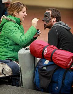 GOING GLOBAL: French tourists Laurine Maignant and Sam Boggio show their true colours as they paint their faces black in Garden Place.