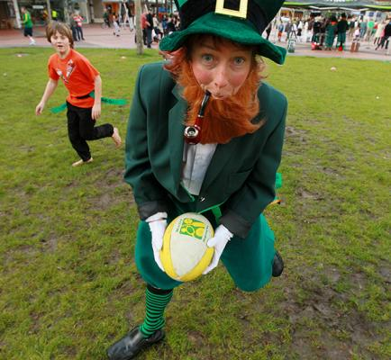 PIPE DOWN: An Irish leprechaun, aka Anne Ferrier-Watson, showed that the Irish can even play rugby wearing a suit and smokin, in Garden Place.