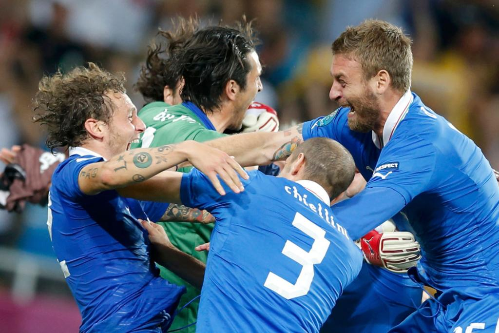 Italian goalkeeper Gianluigi Buffon is mobbed by team-mates after England were beaten in their Euro 2012 quarter-final.