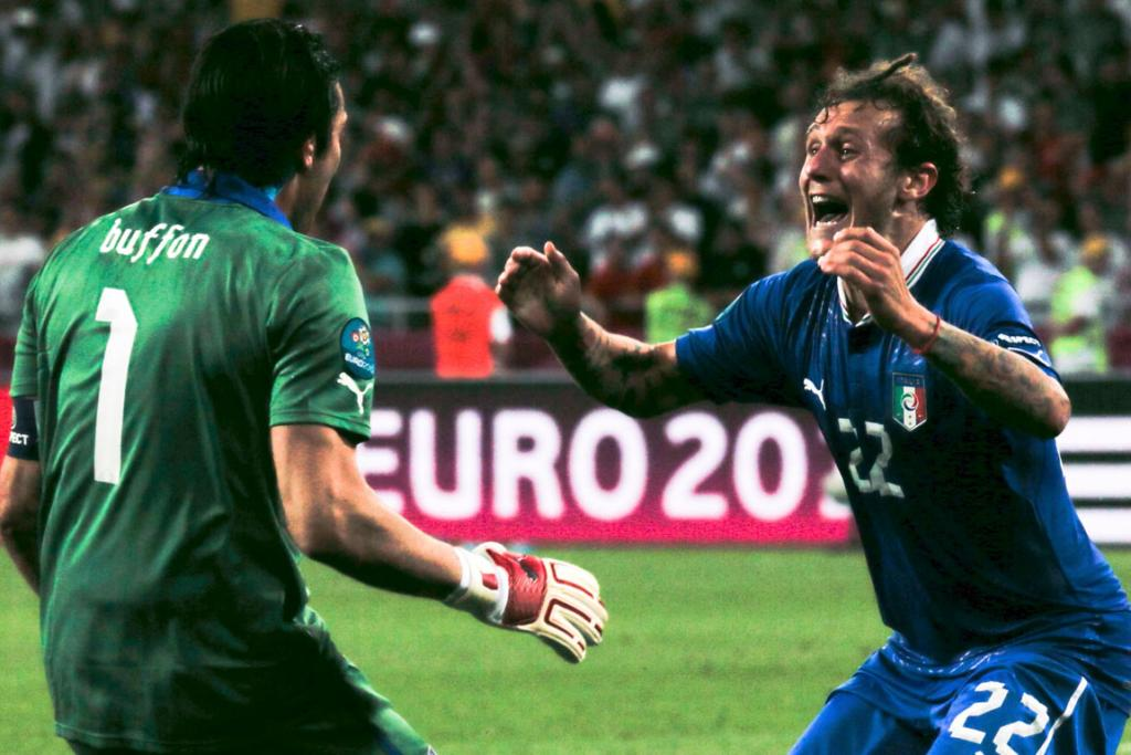 Italy goalkeeper Gianluigi Buffon and final penalty-taker Alessandro Diamanti celebrate after winning the penalty shootout against England.