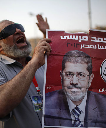 NEW LEADER: A supporter of Muslim Brotherhood's presidential candidate Mohamed Morsy during a rally in Tahrir Square.