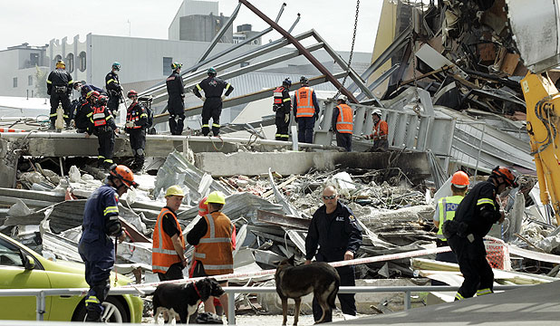 CRITICAL WEAKNESSES: Search teams at work after the CTV building collapsed in February last year.