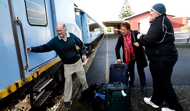 LUCKY LAST: Ian Daily ushers the final northbound passengers on to the Overlander at Feilding. Pete Russell and Mana Peita caught up with the train after missing their booked pickup in Palmerston North.