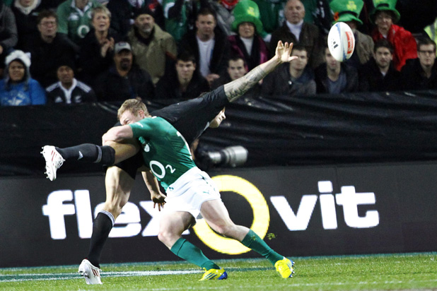 Sonny Bill Williams makes a pass after being tackled by Keith Earls.