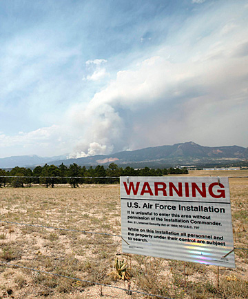 BURNING: A wildfire bears down on the city of Colorado Springs and the US Air Force Academy.