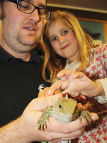 Ecoworld manager Regan Russell with daughter Xaria Russell, 6, stroking a four-year-old Cook Strait Island tuatara.