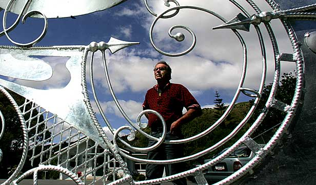 Artist Brendan Nolan with the gate he made for Paekakariki School in 2006.