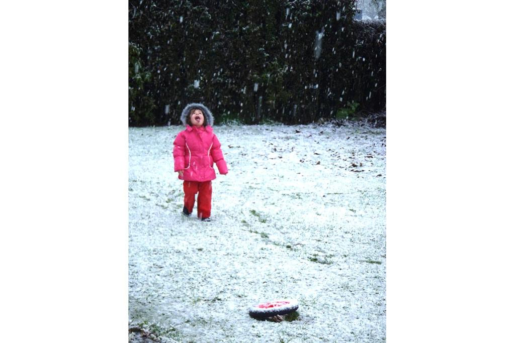 Three-year-old Maia's first time seeing snow, in Kowhitirangi, Hokitika.