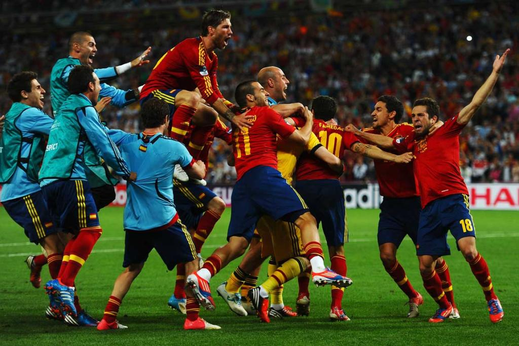 Spain players celebrate victory after winning their semi-final match against Portugal, which ended in a penalty shootout.