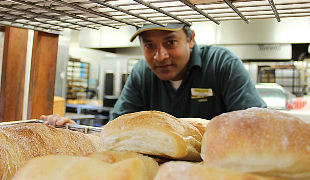 EARNING A CRUST: Mahesh Hettiarachchi is a familiar face in the bakery of Lincoln Rd Pak 'n' Save in Henderson.