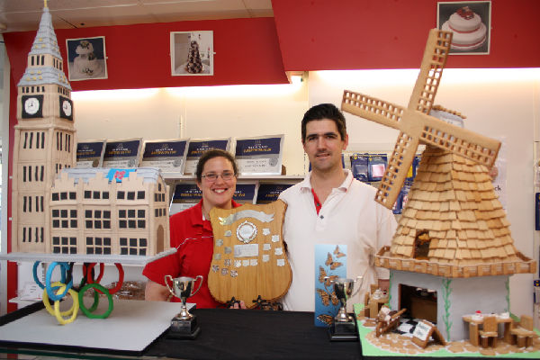 Sugary architecture: Thomas Thomas and his wife Mary with their decorative Big Ben cake and a gingerbread windmill.