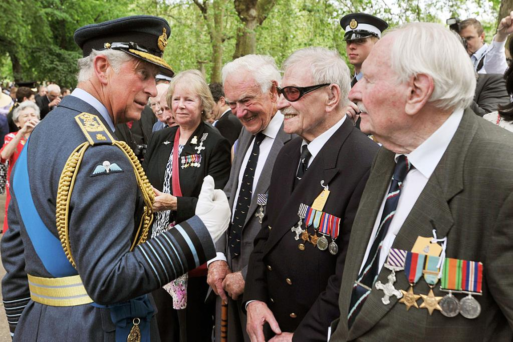 Prince Charles speaks with former members of WWII RAF Bomber Command.