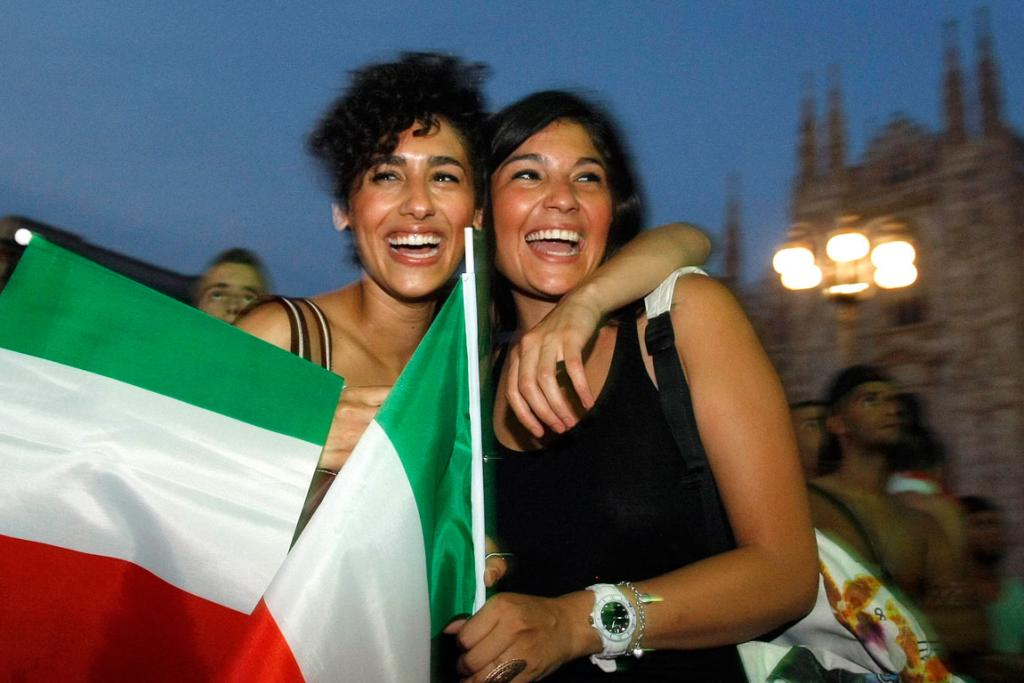 Italian fans celebrate at an outdoor screening in Milan.