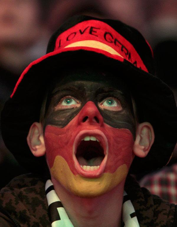 A German fan tries to roar his team on during their semi-final loss to Italy.