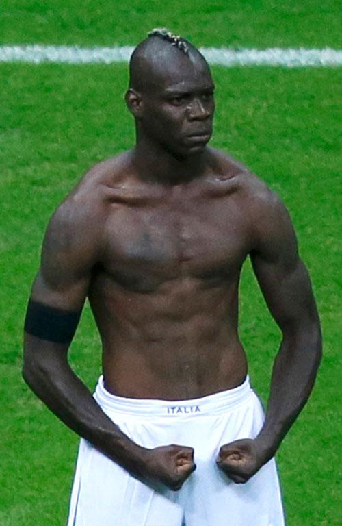 Italian striker Mario Balotelli strikes a pose after his second goal.