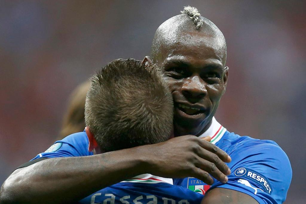 A team-mate congratulates Mario Balotelli after his first goal for Italy in their 2-1 semi-final defeat of Germany at Euro 2012.