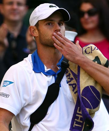Andy Roddick blows a kiss to the crowd after losing to David Ferrer in the third of the Wimbledon 2012.