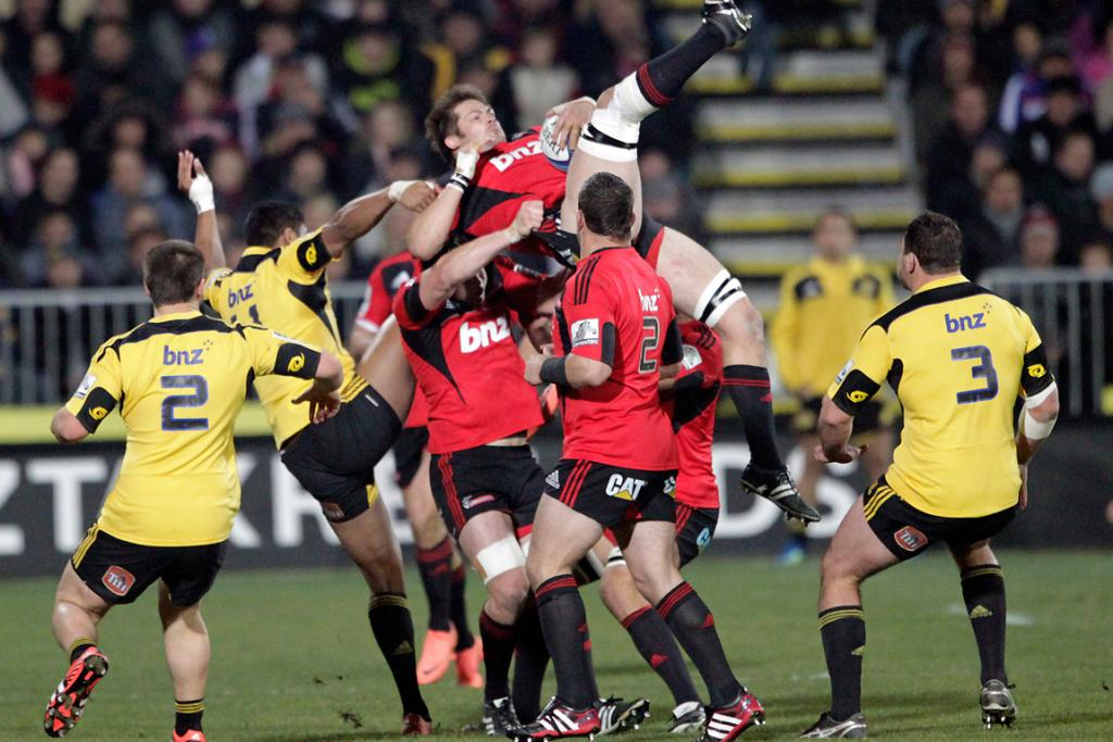 Crusaders' Richie McCaw gets up-ended going for the high ball.