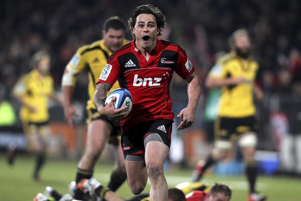 Zac Guildford of the Crusaders runs away to score a try against the Hurricanes.