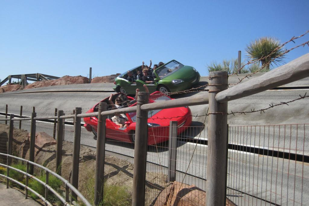 Punters drive six seater cars as part of the Radiator Springs Racers.