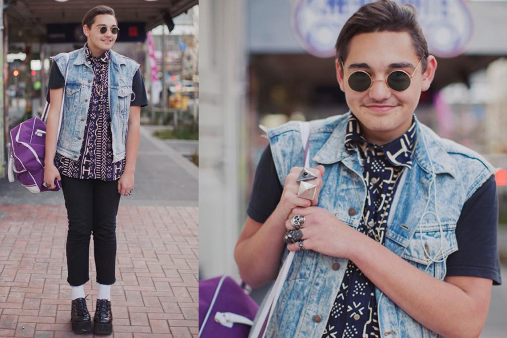 Josh, photographed on Cuba St, Wellington, wearing creepers from Hunters and Collectors, a vintage denim vest, a thrifted shirt and glasses.