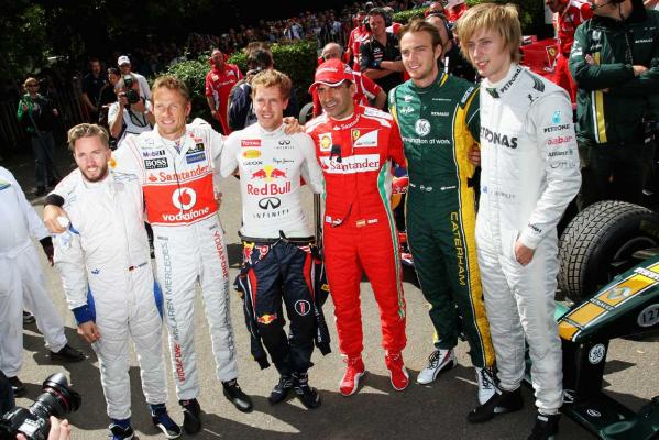 Nick Heidfeld, Jenson Button, Sebastian Vettel, Marc Gene, Giedo Van der Garde and Brendon Hartley at the 2012 Goodwood Festival of Speed in Chichester, England.