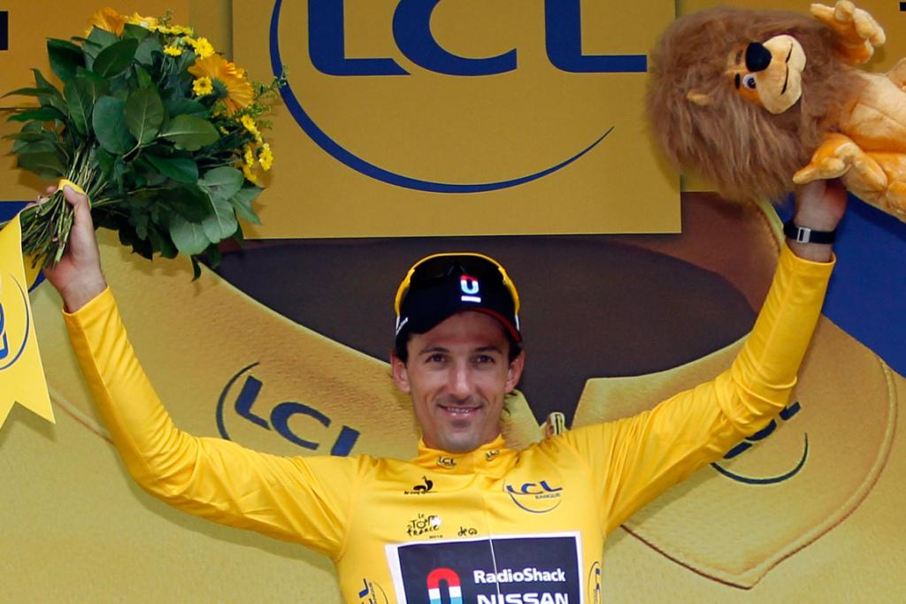 Radioshack-Nissan rider Fabian Cancellara of Switzerland wears the leader's yellow jersey on the podium after the second stage of the Tour de France.