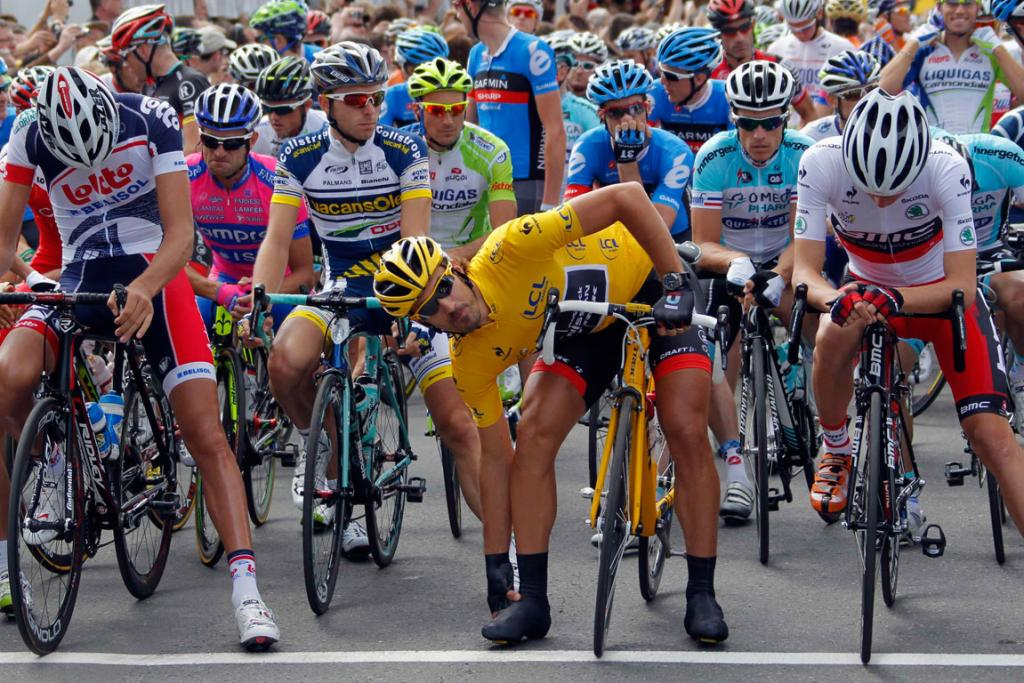 RadioShack-Nissan rider and leader's yellow jersey Fabian Cancellara waits with the pack of riders for the start of the first stage of the Tour de France.