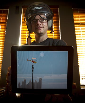 PIXEL THIS: Peter Vullings with the iPad App his company developed for the Rescue Helicopter in Auckland.