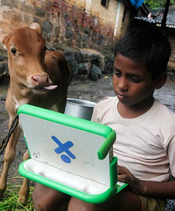 GLOBAL PROGRAMME: A boy uses a laptop from the One Laptop Per Child initiative in India.