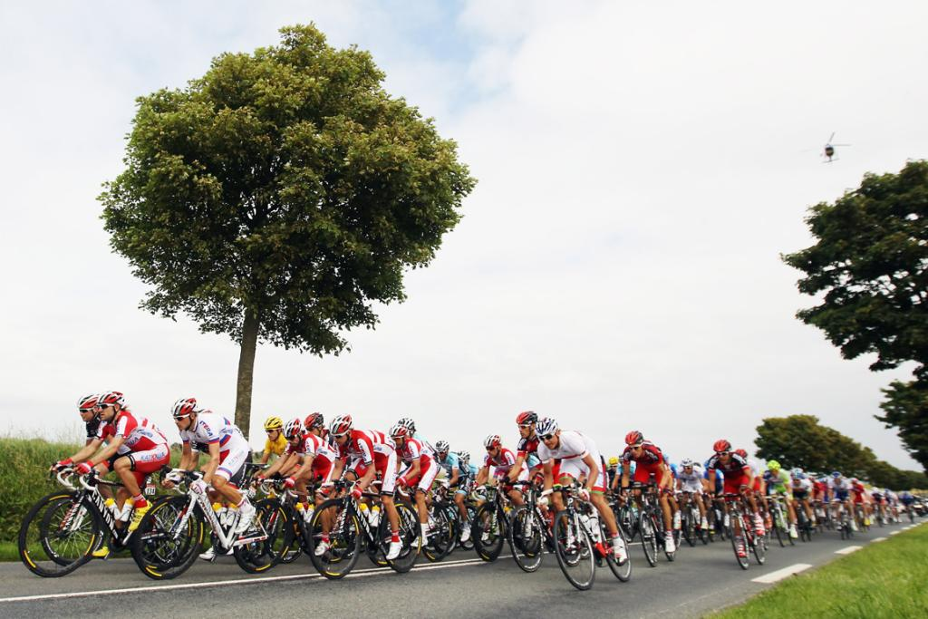 The peleton ride through the French countryside during stage three.