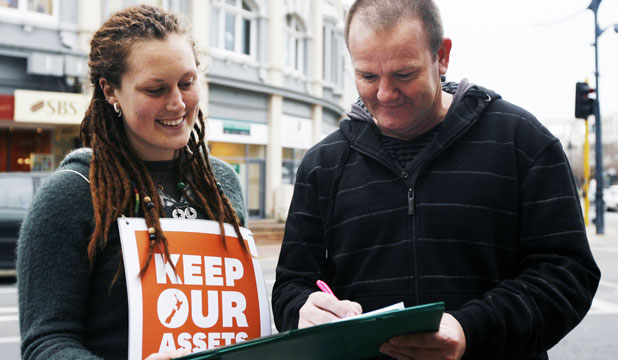 KEEP OUR ASSETS: Tash Turner gets Brett Jenkins to sing the Keep Our Assets petition in a bid to trigger a referendum on the controversial state asset sales.