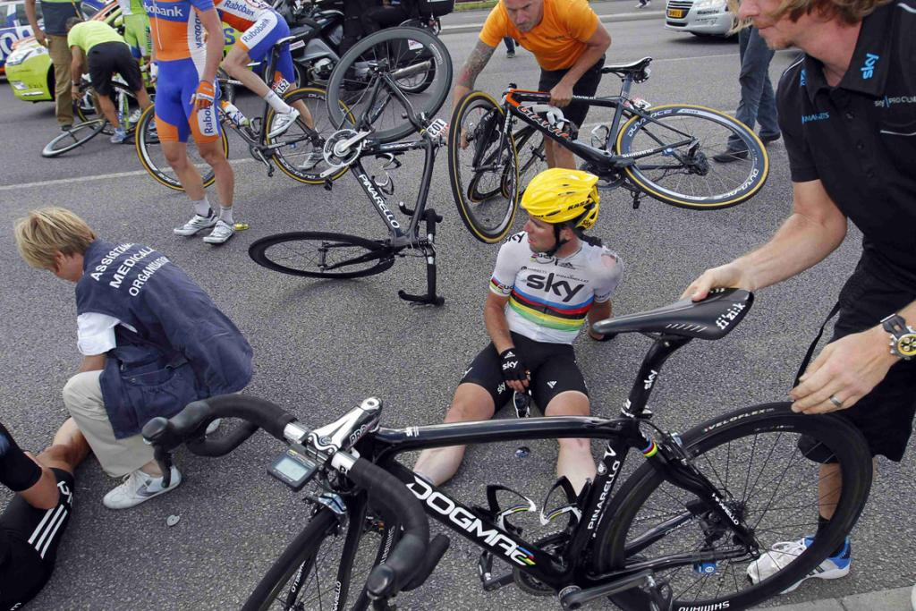 Team Sky rider Mark Cavendish of Britain sits on the ground after a fall during the fourth stage of the 2012 Tour de France.