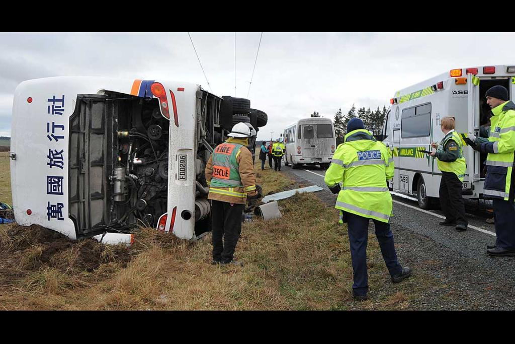The scene after a bus carrying Chinese tourists flipped after the driver lost control on black ice near Mossburn.